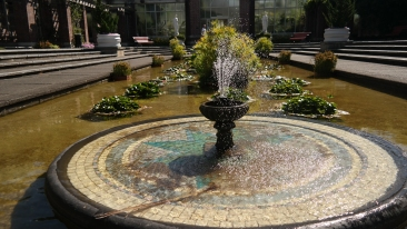 A fountain outside the glass houses