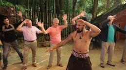 A Maori showing the men the Haka