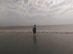 Sam wading in the sea